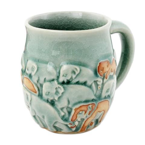 Handmade Light Blue Elephant Herd Celadon ceramic mug