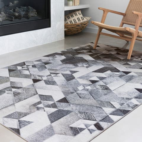 Alexander Home Davide Faux Cowhide Area Rug