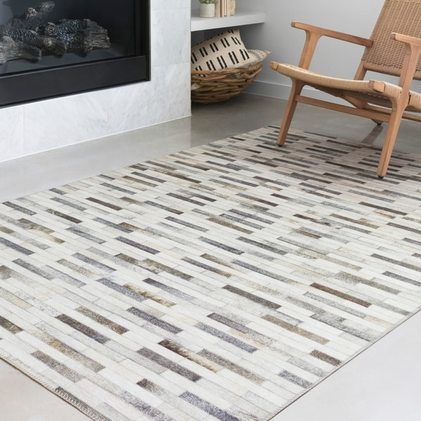 Shop Alexander Home Davide Faux Cowhide Area Rug