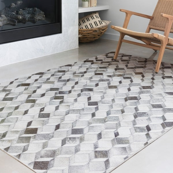 Alexander Home Davide Printed Faux Cowhide Area Rug. Opens flyout.