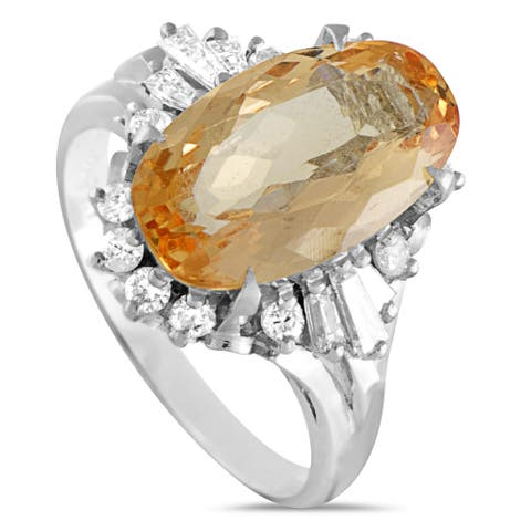Pre-Owned Platinum Round and Tapered Baguette Diamonds and Imperial Orange Oval Topaz Ring Size 6.25