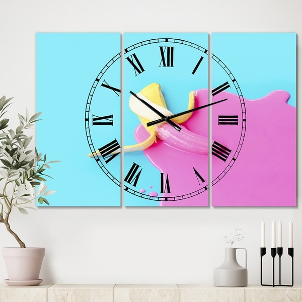 Designart 'Pink And Blue Banana' Large Modern Wall Clock - 3 Panels - 36 in. wide x 28 in. high - 3 Panels