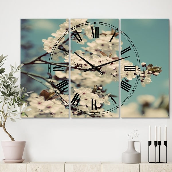 Designart 'White Spring Blossom' Oversized Cottage Wall Clock - 3 Panels - 36 in. wide x 28 in. high - 3 Panels