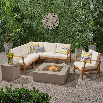 Matching sectional sofa and accent chair surrounding outdoor home fire pit. Shop stylish sofas chairs and sectionals and save online with Overstock