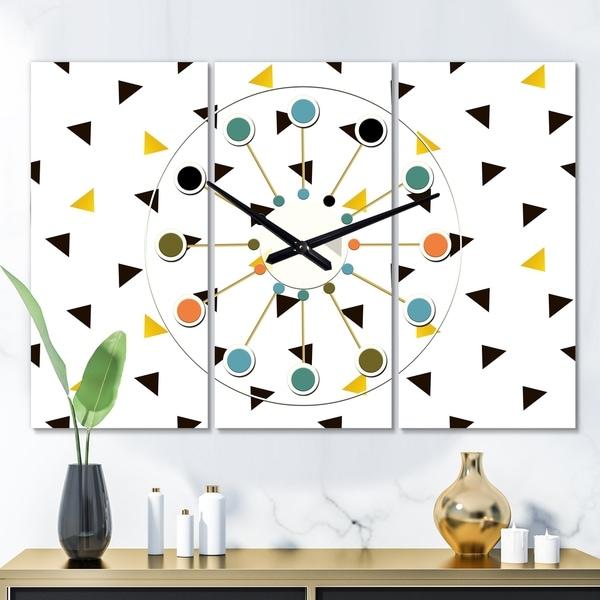 Designart 'Trendy Black and Gold Triangular Pattern ' Oversized Mid-Century wall clock - 3 Panels