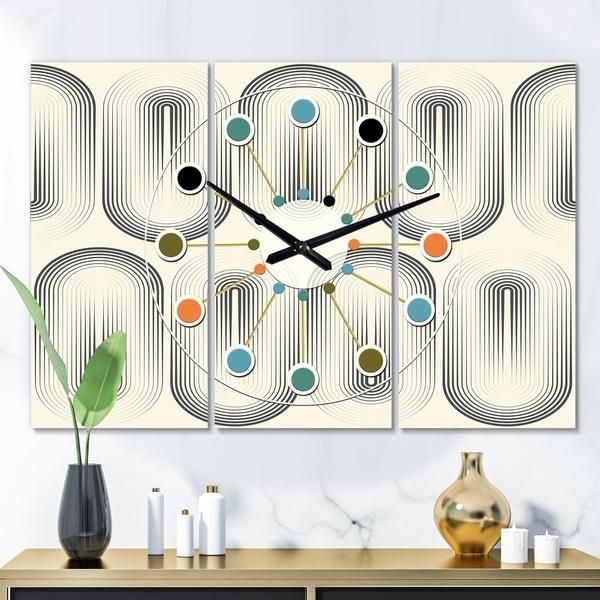 Designart 'Retro Curved Minimal Geometric Ornament I' Oversized Mid-Century wall clock - 3 Panels. Opens flyout.