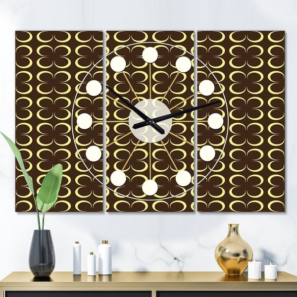Designart 'Floral Retro Pattern II' Oversized Mid-Century wall clock - 3 Panels - 36 in. wide x 28 in. high - 3 Panels