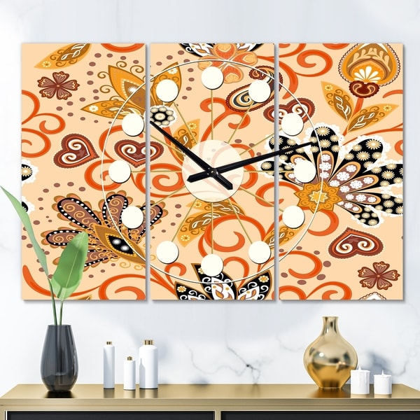 Designart 'Retro Indian Floral Batik III' Oversized Mid-Century wall clock - 3 Panels - 36 in. wide x 28 in. high - 3 Panels. Opens flyout.