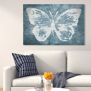 Oliver Gal 'Traveling Blue Butterfly' Animals Wall Art Canvas Print - Blue, White