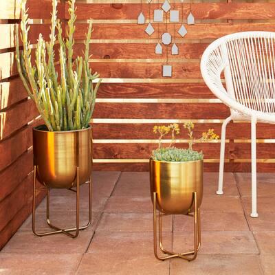 "Studio 350 Contemporary Style Round Indoor/Outdoor Metallic Gold Metal Planters in Gold Stands, Set of 2: 10"" x 16"", 8"" x 13"""