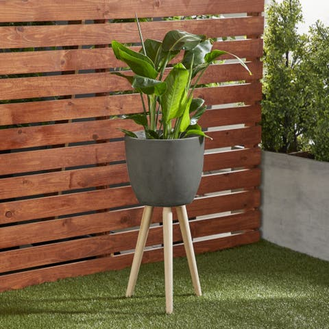 Modern Large Round Black Clay Plant Stand with Tripod Wood Base by Havenside Home