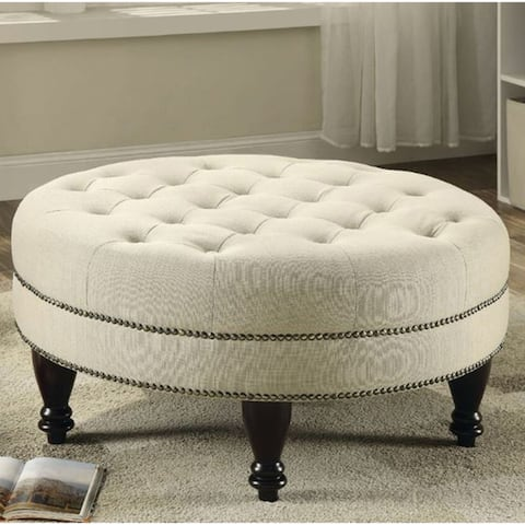 Copper Grove Anenii Traditional Round Cocktail Ottoman with Off-white Fabric Upholstery and Nickel Nailhead Trim