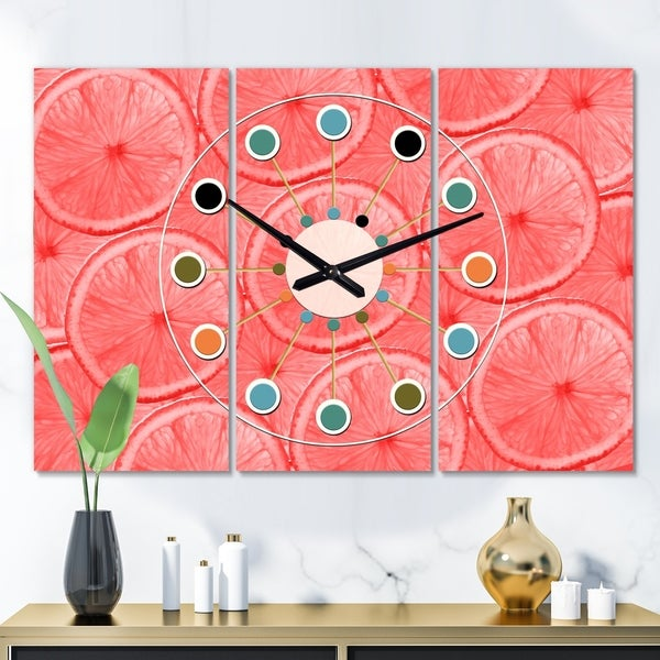 Designart 'Coral Grapefruit Slices' Oversized Mid-Century wall clock - 3 Panels - 36 in. wide x 28 in. high - 3 Panels