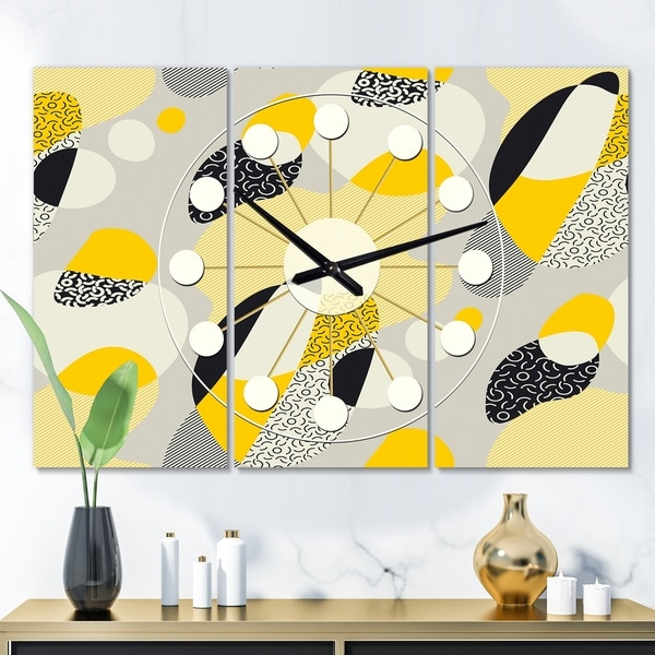 Designart 'Abstract Design Retro Pattern V' Oversized Mid-Century wall clock - 3 Panels - 36 in. wide x 28 in. high - 3 Panels. Opens flyout.