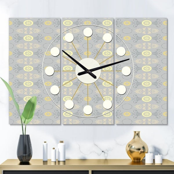 Designart 'Golden Cornflower Pattern' Oversized Mid-Century wall clock - 3 Panels - 36 in. wide x 28 in. high - 3 Panels