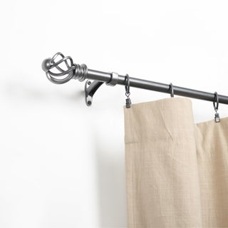 Link to Miranda Haus Spiral Glacier Grey Iron Expandable Curtain Rod Similar Items in Window Treatments