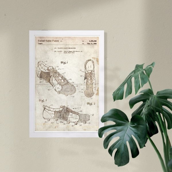 Wynwood Studio 'Training shoe for soccer 1980 Parchment' Sports and Teams Framed Wall Art Print - Brown, White - 13 x 19