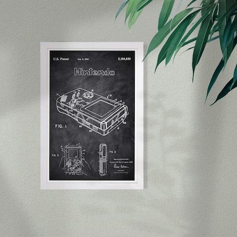 Wynwood Studio 'Gameboy 1993 Chalkboard' Entertainment and Hobbies Framed Wall Art Print - Black, White