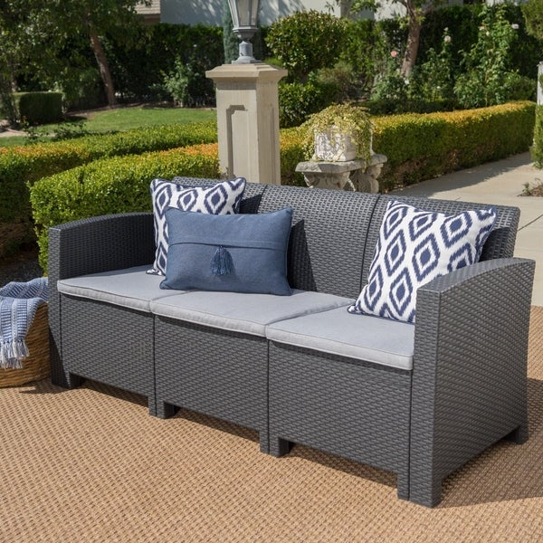 St. Paul Outdoor 3 Seater Faux Wicker Rattan Style Sofa with Water Resistant Cushions by Christopher Knight Home. Opens flyout.