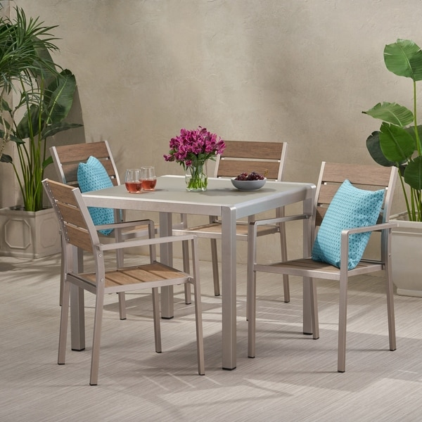 Cape Coral Outdoor Modern 4 Seater Aluminum Dining Set with Faux Wood Seats by Christopher Knight Home. Opens flyout.