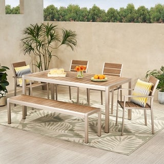 Link to Cape Coral Outdoor Modern 6 Seater Aluminum Dining Set with Dining Bench by Christopher Knight Home Similar Items in Patio Furniture