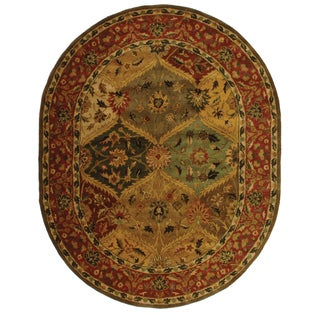 Safavieh Handmade Heritage Traditional Kerman Burgundy Wool Rug (4'6 x 6'6 Oval)