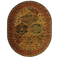 "Safavieh Handmade Heritage Traditional Kerman Burgundy Wool Rug - 4'6"" x 6'6"" oval"