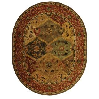 Safavieh Handmade Heritage Traditional Kerman Burgundy Wool Rug (7'6 x 9'6 Oval)