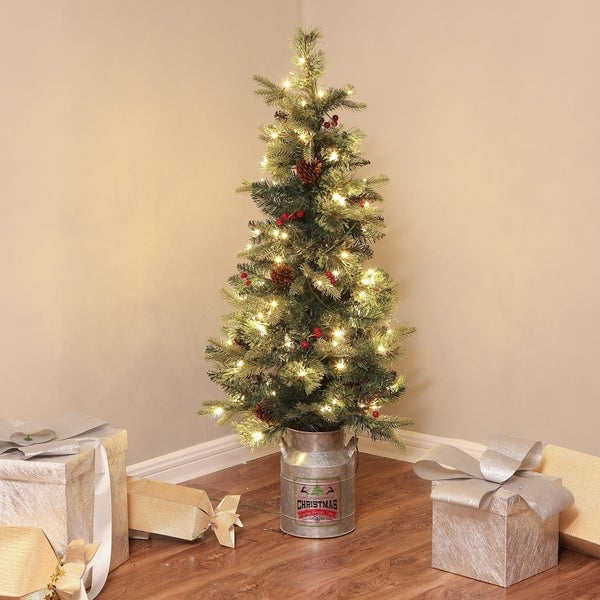 Pre-lit LED 4-ft. Faux Christmas Tree with Metal Pot. Opens flyout.