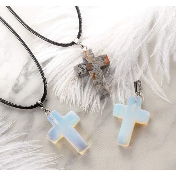 lot of cross charms and pendants
