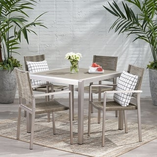 Link to Peridot Outdoor Modern 4 Seater Aluminum Dining Set with Faux Wood or Faux Rattan Table Top by Christopher Knight Home Similar Items in Outdoor Dining Sets