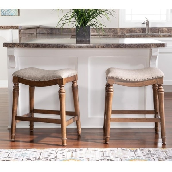 Copper Grove Barmstedt Brown Counter Stool with Beige Saddle Seating - N/A. Opens flyout.