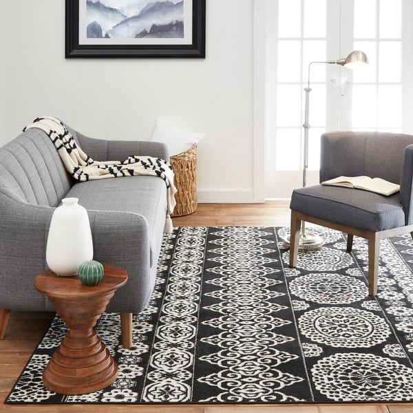 The Curated Nomad Tracy Black and Ivory Geometric Area Rug