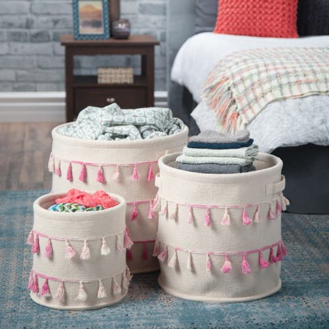 WYNDENHALL Merle Transitional 3 Pc Nesting Storage Basket Set in Natural with Pink Tassels - 16 inch wide