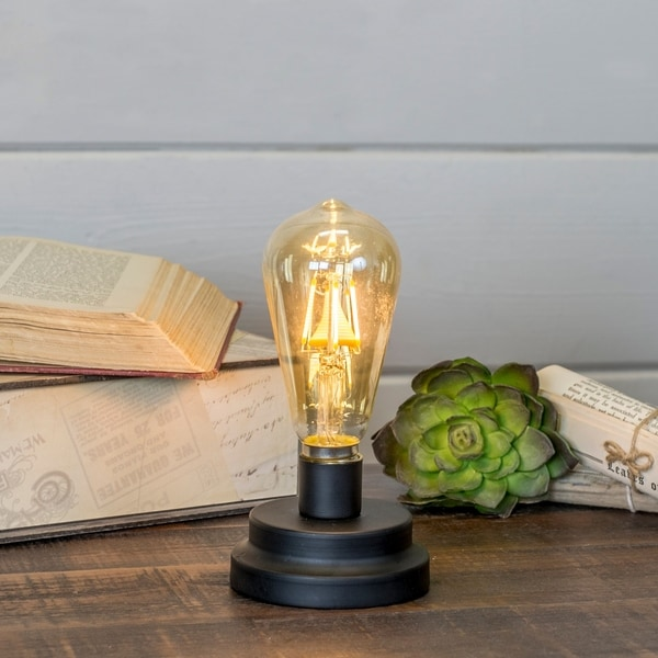 Decorative light with metal base. Opens flyout.