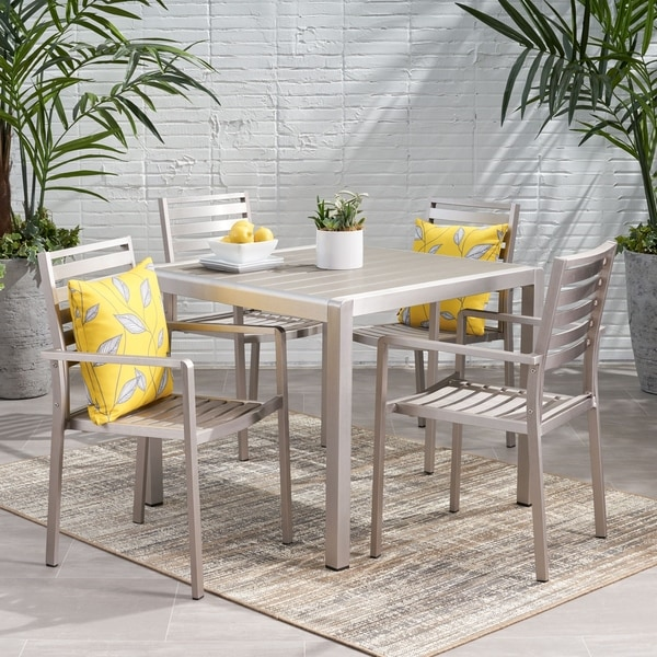 Cape Coral Outdoor Modern 4 Seater Aluminum Dining Set with Faux Wood Table Top by Christopher Knight Home