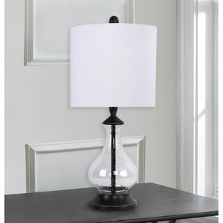 Link to Porch & Den Kirsten Clear Seeded Glass 22-inch Accent Lamp with Off-White Linen Drum Shade Similar Items in Living Room Furniture