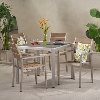 Link to Cape Coral Outdoor Modern 4 Seater Aluminum Dining Set with Faux Wood Seats by Christopher Knight Home Similar Items in Outdoor Dining Sets