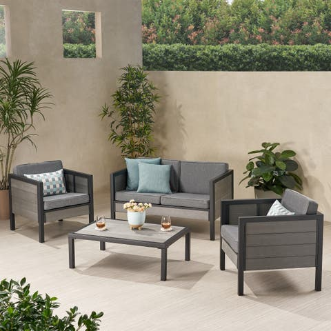 Jax Outdoor 4 Seater Faux Wood Chat Set with Cushions by Christopher Knight Home