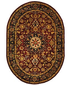 Safavieh Handmade Classic Kerman Burgundy/ Navy Wool Rug (4'6 x 6'6 Oval)