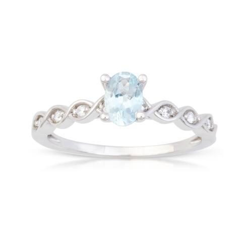 Oval Cut Aquamarine Gemstone 1/20ct TDW Diamond Classic Ring in 10k White Gold