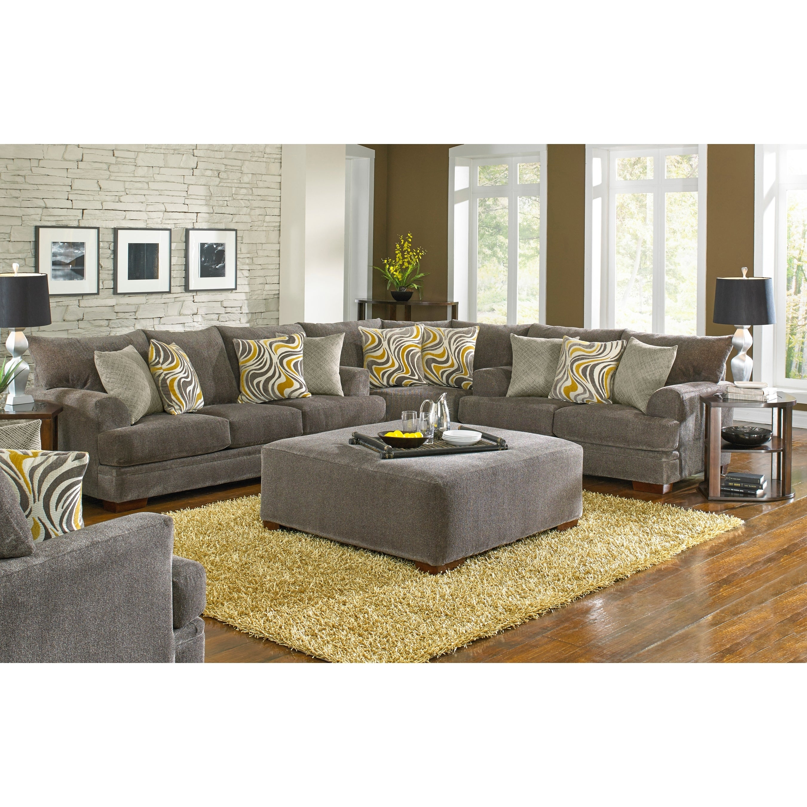 Sybil Sectional And Ottoman Living Room Set