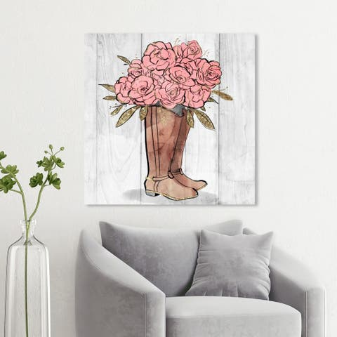 Wynwood Studio 'Rider Boots Flowers' Floral and Botanical Wall Art Canvas Print - Pink, Brown