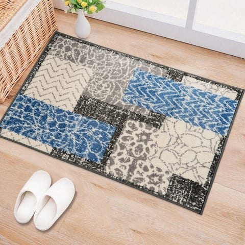 Distressed Geometric Floral Patchwork Area Rug
