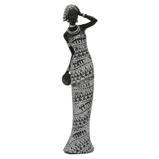 African Figurine in Black Resin / Magnesium 4in L x 4in W x 17in H