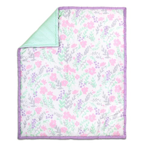 The Peanut Shell Floral Cotton Quilt in Purple/Mint