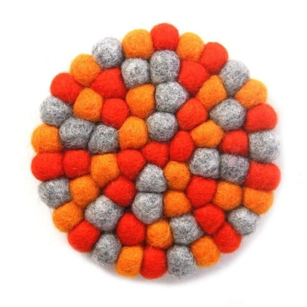 The Curated Nomad Southard Chakra Colors Felt Ball Trivet. Opens flyout.