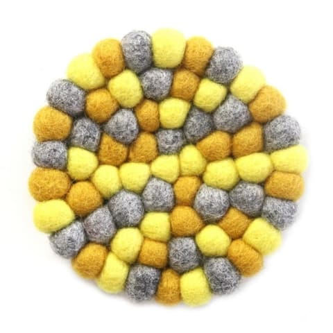 The Curated Nomad Southard Chakra Colors Felt Ball Trivet