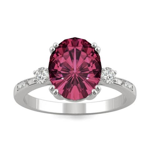 14k White Gold Moissanite by Charles & Colvard Oval Seven Stone Ring with Lab Created Ruby