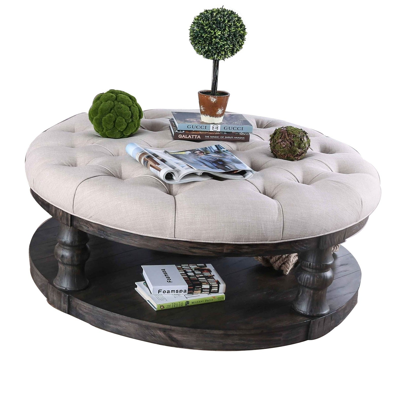 wooden coffee table with padded top and bottom shelf brown and beige